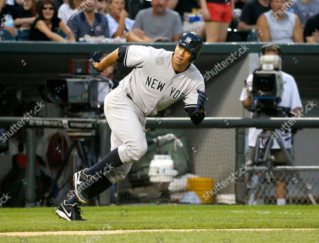 Alex Rodriguez New York Yankees' Alex Rodriguez hustles back to third and is unable to score on Vernon Wells' bloop RBI single off a pitch from Chicago White Sox's Hector Santiago, scoring Alfonso Soriano, during the third inning of a baseball game, in Chicago
