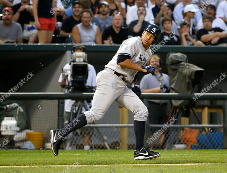 Alex Rodriguez New York Yankees' Alex Rodriguez hustles back to third and is unable to score on Vernon Wells' bloop RBI-single off a pitch from Chicago White Sox's Hector Santiago during the third inning of a baseball game, in Chicago