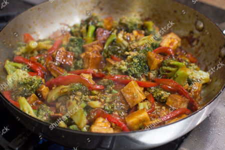 This photo shows sauteed tofu with broccoli and red peppers in chili-orange sauce in Concord, N.H. This dish is from a recipe by Sara Moulton