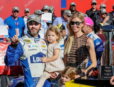 Jimmie Johnson, Chandra Johnson, Lydia Johnson, Genevieve Johnson Jimmie Johnson celebrates in Victory Lane with his wife, Chandra, and daughters Lydia and Genevieve, standing after winning a NASCAR Sprint Cup Series auto race, at Charlotte Motor Speedway in Concord, N.C