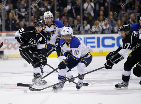 Andy McDonald St. Louis Blues' Andy McDonald, center, controls the puck during the third period in Game 3 of a first-round NHL hockey Stanley Cup playoff series against the Los Angeles Kings in Los Angeles, . The Kings won 1-0
