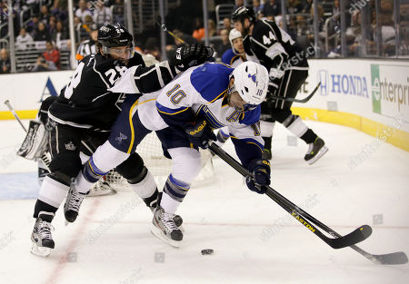 Jarret Stoll, Andy McDonald Los Angeles Kings center Jarret Stoll, left, pushes St. Louis Blues center Andy McDonald off the puck during the first period in Game 6 of a first-round NHL hockey Stanley Cup playoff series in Los Angeles