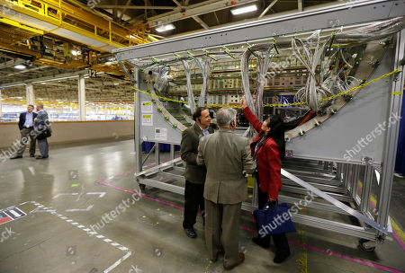 Linda Lee Boeing's Linda Lee, right, shows aviation journalists details of a cross section mockup of the structure of what will be the new Boeing 737 MAX airplane on display at the 737 assembly facility in Renton, Wash