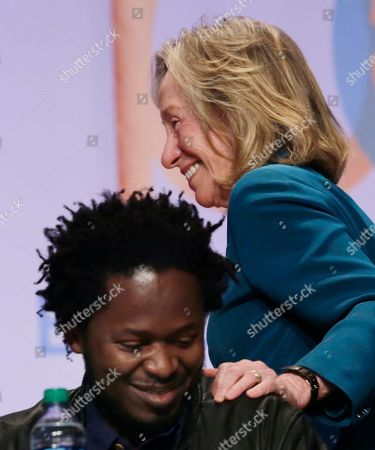 """Ishmael Beah, Doris Kearns Goodwin Author Doris Kearns Goodwin stands to speak and pats author Ishmael Beah on the shoulder after he spoke at Book Expo America, in New York. Goodwin's next book, """"The Bully Pulpit: Theodore Roosevelt, William Howard Taft and the Golden Age of Journalism,"""" will be released in October. Beah's latest novel, """"The Radiance of Tomorrow,"""" will be released in January, 2014"""