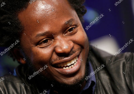 """Ishmael Beah Author Ishmael Beah poses for photos at Book Expo America, in New York. Beah's latest novel, """"The Radiance of Tomorrow,"""" will be released in January, 2014"""