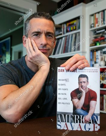 "Dan Savage On, author Dan Savage is in his home in Seattle. Savage's latest book, ""American Savage,"" was released on Tuesday, May 28"