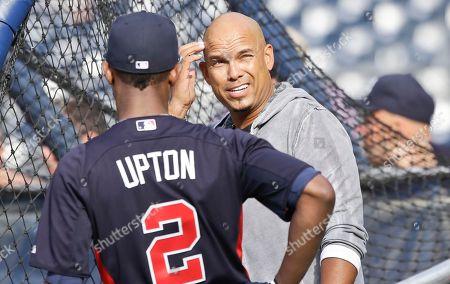 Justin Upton, David Justice Former Atlanta Braves player David Justice talks with Justin Upton during warmups prior to a baseball game in San Diego