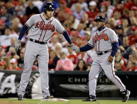 Freddie Freeman, Terry Pendleton Atlanta Braves' Freddie Freeman, left, is congratulated by first base coach Terry Pendleton after driving in a run with a single off Cincinnati Reds starting pitcher Homer Bailey in the fifth inning of a baseball game, in Cincinnati
