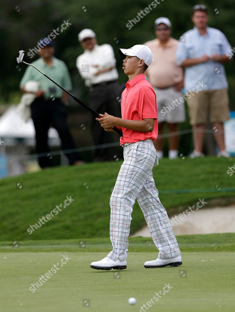 Guan Tianlang Amateur Guan Tianlang, 14, of China reacts to missing on a birdie attempt on the 10th green during the first round of the Byron Nelson Championship golf tournament, in Irving, Texas