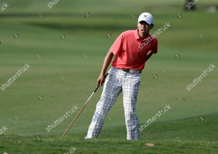 Guan Tianlang Amateur Guan Tianlang, 14, of China looks down the fairway before hitting on his approach to the 15th green during the first round of the Byron Nelson Championship golf tournament, in Irving, Texas