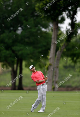 Guan Tianlang Amateur Guan Tianlang, 14, of China watches his approach shot onto the 10th green during his first round of the Byron Nelson Championship golf tournament, in Irving, Texas