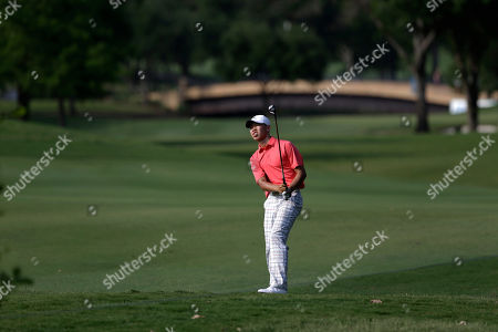 Guan Tianglang Amateur Guan Tianlang, 14, of China watches his shot off the 15th fairway during the first round of the Byron Nelson Championship golf tournament, in Irving, Texas