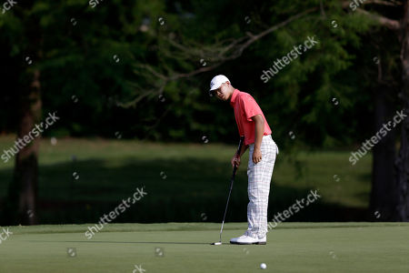 Guan Tianlang Amateur Guan Tianlang, 14, watches his putt on the 14th green during his first round of the Byron Nelson Championship golf tournament, in Irving, Texas