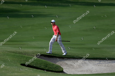 Guan Tianglang Amateur Guan Tianlang, 14, of China walks up onto the 15th green during the first round of the Byron Nelson Championship golf tournament, in Irving, Texas