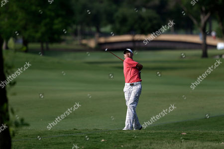 Guan Tianglang Amateur Guan Tianlang, 14, of China hits off the 15th fairway during the first round of the Byron Nelson Championship golf tournament, in Irving, Texas
