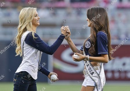 Mabelynn Capeluj, Cassidy Wolf MIss California Mabelynn Capeluj, right, and Miss California Teen USA Cassidy Wolf, both from San Diego, high five each other prior to throwing out the ceremonial first pitches before the baseball game between the San Diego Padres and St. Louis Cardinals in San Diego