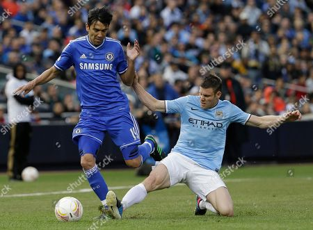 James Milner, Paulo Ferreira Manchester City midfielder James Milner, right, makes a tackle against Chelsea defender Paulo Ferreira during the second half of an exhibition international friendly soccer match, at Yankee Stadium in New York. Manchester City won 5-3