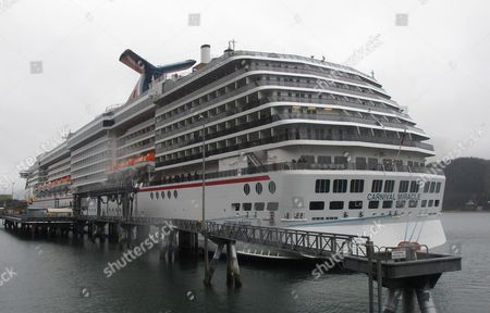 The Carnival Miracle docked in Juneau, Alaska. The nation's largest cruise ship company will adopt technology from power plants and automobiles to reduce air pollution from the massive diesel engines powering its ships. In a tentative agreement reached Thursday with the Environmental Protection Agency (EPA), Carnival Corp. will deploy scrubbers to reduce sulfur dioxide and filters to trap soot on as many as 32 ships over the next three years. At port, ships will plug into the electrical grid, rather than idle, to reduce pollution