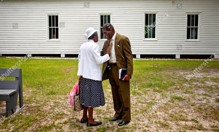 Annie Watts, Stephen Wilson Annie Watts, 74, left, and Stephen Wilson, 68, talk after a church service for the 129th anniversary of St. Luke Baptist Church on Sapelo Island, Ga. on . Wilson is one of roughly 47 residents, most of them descendants of West African slaves known as Geechee, who remain on the coastal Georgia island where their ancestors were brought to work a plantation in the early 1800s