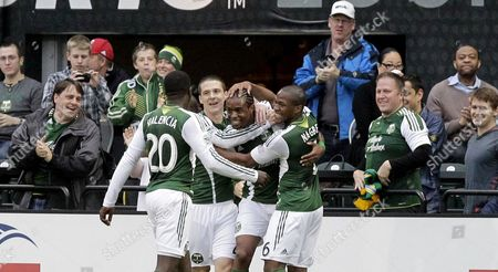 Frederic Piquionne, Jose Valencia, Will Johnson, Darlington Nagbe Portland Timbers forward Frederic Piquionne, second from right, celebrates after scoring his third goal with teammates, from left, Jose Valencia, Will Johnson and Darlington Nagbe during the first half of a U.S. Open third round soccer game against the Wilmington Hammerheads in Portland, Ore