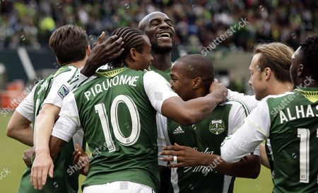 Frederic Piquionne Portland Timbers forward Frederic Piquionne, second from left, celebrates scoring his second goal during the first half of a U.S. Open third-round soccer game against the Wilmington Hammerheads in Portland, Ore