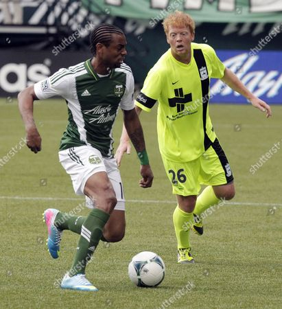 Frederic Piquionne, Cory Elenio Portland Timbers forward Frederic Piquionne, left, maneuvers the ball against Wilmington Hammerhead forward Cory Elenio during the first half of a U.S. Open third-round soccer game in Portland, Ore