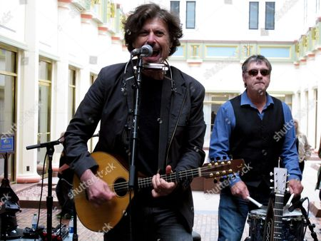 Eric Bazilian of the Hooters sings while the rock band plays in the East Rotunda of the Pennsylvania Capitol on Hooters Music Appreciation Day, in Harrisburg, Pa. The Philadelphia-area band formed in 1980 and the state Senate unanimously passed a resolution to honor them