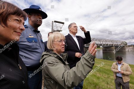 Patty Murray, Jay Inslee, Will Reichardt Rep. Suzan DelBene, D-Wash., left, Washington State Patrol chief John Batiste, Sen. Patty Murray, D-Wash., and Gov. Jay Inslee talk about and view the collapsed portion of the Interstate 5 bridge behind them, in Mount Vernon, Wash. Inslee says federal officials are searching the country for a possible temporary replacement for a bridge that collapsed along the crucial Interstate 5 corridor. A truck carrying an oversize load struck the four-lane bridge on the major thoroughfare between Seattle and Canada, sending a section of the span and two vehicles into the Skagit River below Thursday evening. All three occupants suffered only minor injuries