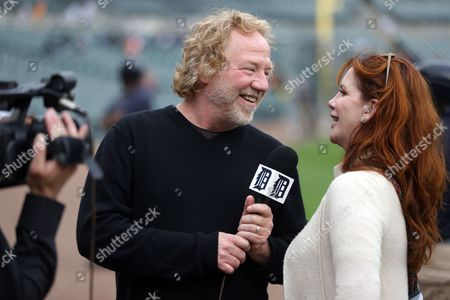 Timothy Busfield, Melissa Gilbert Actor Timothy Busfield interviews his wife Melissa Gilbert as they are filmed by a Detroit Tigers videographer before the start of a baseball game between the Tigers and the Cleveland Indians, in Detroit