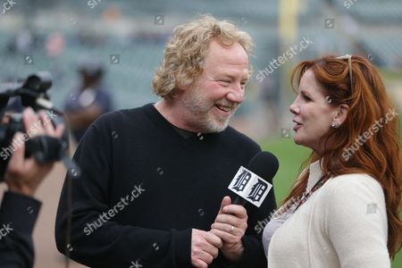 Timothy Busfield, Melissa Gilbert Actor Timothy Busfield interviews his wife Melissa Gilbert as they are filmed by a Detroit Tigers videographer before the start of a baseball game in Detroit
