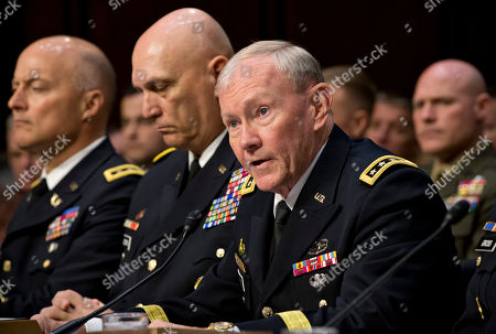 Martin Dempsey, Raymond T. Odierno, Dana K. Chipman Chairman of the U.S. Joint Chiefs of Staff, Gen. Martin Dempsey, right, testifies on Capitol Hill in Washington. Dempsey has recommended that military American commanders look for ways to help improve the military capabilities of Iraq and Lebanon, which both face the risk of spillover from the civil war in neighboring Syria. From right are, Dempsey, Army Chief of Staff Gen. Ray Odierno, and Judge Advocate General of the Army Lt. Gen. Dana K. Chipman