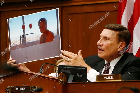 John Mica House Oversight and Government Reform Committee member Rep. John Mica, R-Fla., holds up a picture of a GSA employee in a hot tub as he questions witnesses on Capitol Hill in Washington, during the committee's hearing regarding IRS conference spending