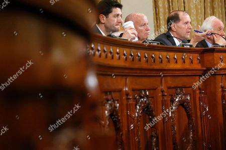 Sander Levin, Dave Camp, Kevin Brady, Paul Ryan House Ways and Means Committee members, from left, Rep. Paul Ryan, R-Wis., Rep. Kevin Brady, R-Texas, committee chairman, Rep. Dave Camp, R-Mich, and the committee's ranking Democrat Rep. Sander Levin, D-Mich., listen to testimony on Capitol Hill in Washington, from ousted IRS Chief Steve Miller and J. Russell George, Treasury Inspector General for Tax Administration, during a hearing on the Internal Revenue Service (IRS) practice of targeting applicants for tax-exempt status based on political leanings