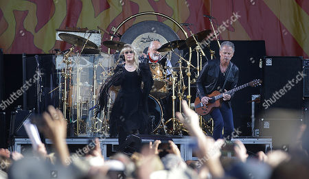 Stock Photo of Stevie Nicks, Mick Fleetwood, Lindsay Buckingham Stevie Nicks, left, Mick Fleetwood, center, and Lindsay Buckingham, are seen on stage as Fleetwood performs at the New Orleans Jazz and Heritage Festival in New Orleans