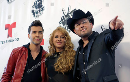 Paulina Rubio, Prince Royce, Roberto Tapia La Voz Kids music coaches, Prince Royce, left, Paulina Rubio, center, and Roberto Tapia pose for photographers after a news conference in Miami, . Telemundo announced that the singing competition La Voz Kids will premiere on Sunday, May 5th