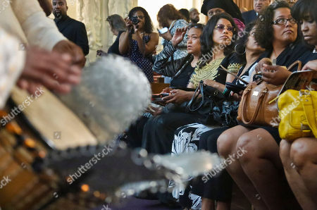 The Sheps Hetep drummers, left, play as the family of Malcolm Latif Shabazz, including his aunts Malaak Shabazz, seated fifth from right, and Ilyasah Shabazz, fourth from right, arrive for his memorial service at the First Corinthian Baptist Church on in the Harlem section of New York. Scores gathered to remember Shabazz, 28, the late grandson of slain civil rights leader Malcolm X, who authorities say was beaten to death in Mexico City
