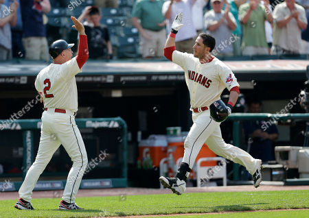 Brad Mills, Yan Gomes Cleveland Indians' Yan Gomes jumps and high-fives Cleveland Indians third base coach Brad Mills as Gomes runs the bases after hitting a game-winning three run home run off Seattle Mariners relief pitcher Charlie Furbush in the tenth inning of a baseball game, in Cleveland. Michael Brantley and Drew Stubbs scored. The Indians won 10-8 in 10 innings