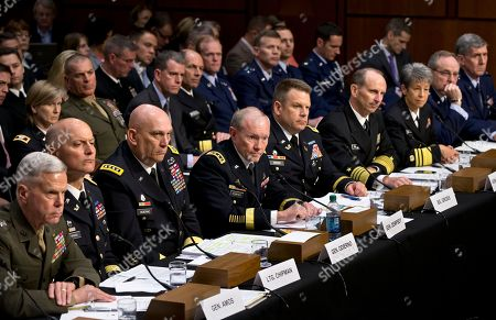 Stock Image of James F. Amos, Dana K. Chipman, Raymond T. Odierno, Martin Dempsey, Richard C. Gross, Jonathan W. Greenert, Nanette M. DeRenzi, Mark A. Welsh III, Richard C. Harding As Congress investigates the growing epidemic of sexual assaults within the military, the Senate Armed Services Committee holds a hearing to demand answers from top uniformed leaders about whether a drastic overhaul of the military justice system is needed, on Capitol Hill in Washington, . From left to right are Commandant of the Marine Corps Gen. James F. Amos, Judge Advocate General of the Army Lt. Gen. Dana K. Chipman, Army Chief of Staff Gen. Raymond T. Odierno, Joint Chiefs Chairman Army Gen. Martin Dempsey, Legal Counsel to the Chairman of the Joint Chiefs of Staff Brig. Gen. Richard C. Gross, Chief of Naval Operations Adm. Jonathan W. Greenert, Judge Advocate General of the Navy Vice Adm. Nanette M. DeRenzi, Air Force Chief of Staff Gen. Mark A. Welsh III, and Judge Advocate General of the Air Force Lt. Gen. Richard C. Harding
