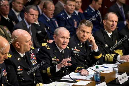 Stock Picture of Dana K. Chipman, Raymond T. Odierno, Martin Dempsey, Richard C. Gross, Jonathan W. Greenert Joint Chiefs Chairman Gen. Martin Dempsey, center, testifies on Capitol Hill in Washington, before the Senate Armed Services Committee hearing investigating the growing epidemic of sexual assaults within the military. The number of reported sexual assaults across the military shot up by more than 50 percent this year. Defense officials suggest that victims are becoming more willing to come forward. The increase follows a tumultuous year of scandals that shined a spotlight on the crimes and put pressure on the military to act aggressively. From left are, Judge Advocate General of the Army Lt. Gen. Dana K. Chipman, Army Chief of Staff Gen. Ray Odierno, Legal Counsel to the Chairman of the Joint Chiefs of Staff Brig. Gen. Richard C. Gross, and Chief of Naval Operations Adm. Jonathan W. Greenert