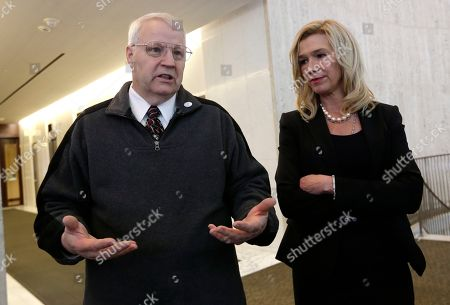 Anne Bremner, Chuck Cox Chuck Cox, left, motions as he describes the search for his missing daughter as he stands with attorney Anne Bremner during a news conference, in Seattle. Bremner said Tuesday there's an ongoing federal investigation into Susan Powell's disappearance. She made the announcement at the Seattle news conference a day after local officials in Utah said they had closed their investigation into the Susan Powell case