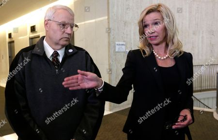 Anne Bremner, Chuck Cox Chuck Cox, left, father of Susan Powell, look on as attorney Anne Bremner speaks during a news conference, in Seattle. Bremner said Tuesday there's an ongoing federal investigation into Powell's disappearance. She made the announcement at the Seattle news conference a day after local officials in Utah said they had closed their investigation into the Susan Powell case
