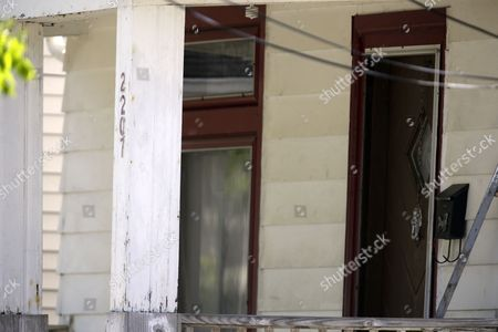 The front entrance to the house where three women were held is shown in Cleveland, Ohio, . Ariel Castro was charged with four counts of kidnapping and three counts of rape. Ariel Castro was charged while his brothers, Pedro and Onil Castro, were held but faced no immediate charges