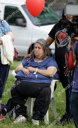 Stock Image of Deborah Knight Deborah Knight, grandmother of Michelle Knight, waits for a balloon release in support of the three women, including her granddaughter Michelle Knight, who were found in a house on Seymour Avenue in Cleveland, Ohio