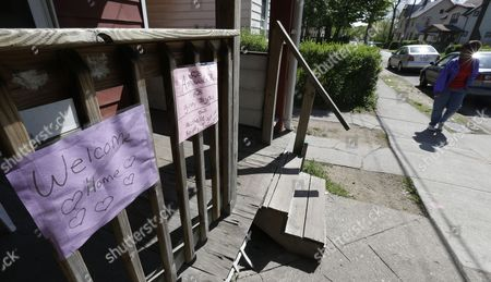 Welcome home signs are shown near Seymour Street where three women were found in Cleveland, Ohio, . Ariel Castro was charged with four counts of kidnapping and three counts of rape. Ariel Castro was charged while his brothers, Pedro and Onil Castro, were held but faced no immediate charges
