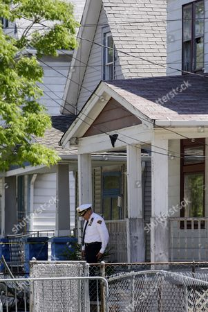 A law enforcement officer leaves the house where three women missing for about a decade were found alive, in Cleveland, . Ariel Castro was charged with kidnapping and rape while his brothers, Pedro and Onil Castro, were arrested and cleared without charges