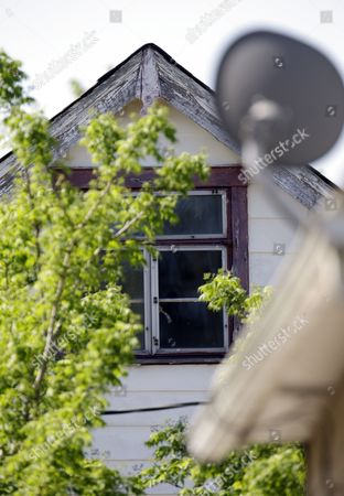 The upper floor window is covered where three women were held in Cleveland, Ohio, . Ariel Castro was charged with four counts of kidnapping and three counts of rape. Ariel Castro was charged while his brothers, Pedro and Onil Castro, were held but faced no immediate charges