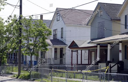 The house is shown where three women were held in Cleveland, Ohio, . Ariel Castro was charged with four counts of kidnapping and three counts of rape. Ariel Castro was charged while his brothers, Pedro and Onil Castro, were held but faced no immediate charges
