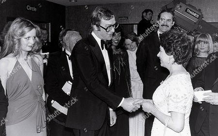Michael Caine and Princess Margaret, John Cleese in background - 1977