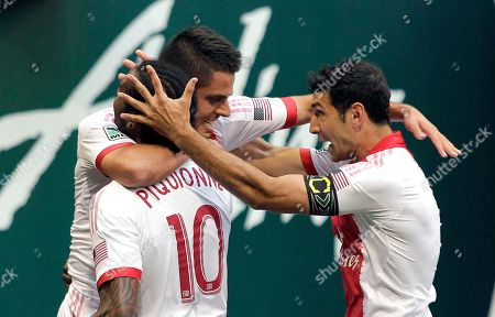 Michael Nanchoff, Frederic Piquionne, Diego Valeri Portland Timbers midfielder Michael Nanchoff, middle, celebrates scoring a goal with teammates Frederic Piquionne, left, and Diego Valeri during the first half of an MLS U.S. Open Cup fourth round soccer game against the Tampa Bay Rowdies in Portland, Ore