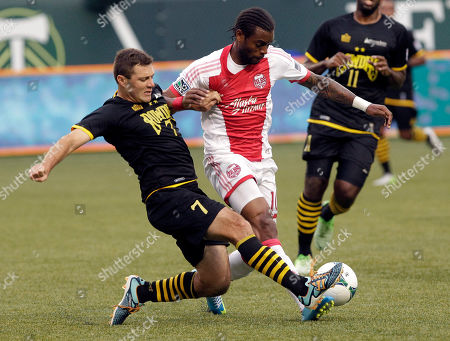 Frankie Sanfilippo, Frederic Piquionne Tampa Bay Rowdies defender Frankie Sanfilippo, left, and Portland Timbers forward Frederic Piquionne battle for the ball during the first half of an MLS U.S. Open Cup fourth-round soccer match in Portland, Ore
